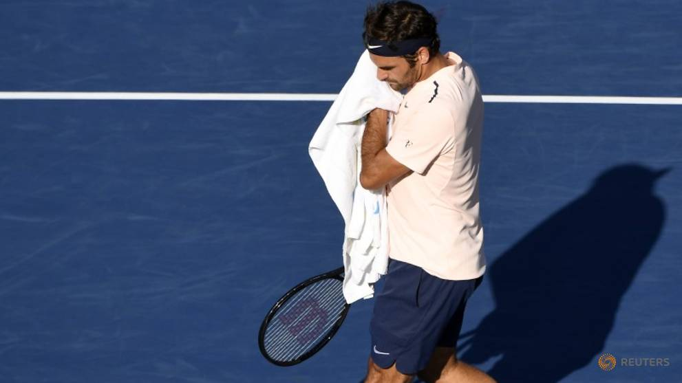 Federer's pullout from Cincinnati hands number one spot to Nadal