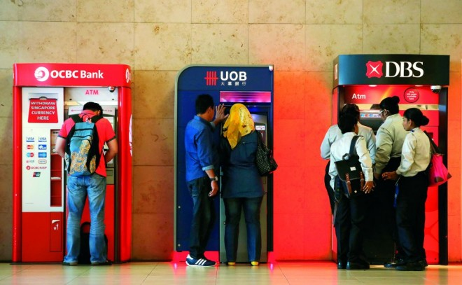 Singaporeans paying up to five times more on sending money overseas: research