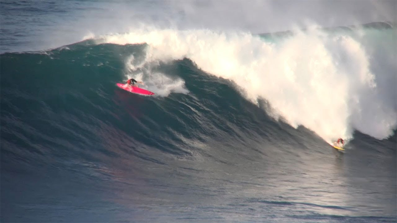 Monster waves wipe out surfers