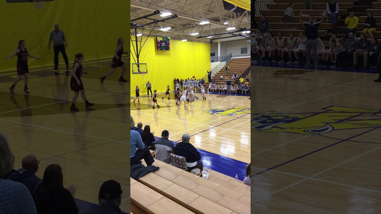 Epic half court shot at basketball game