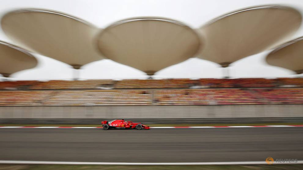 Motor racing - Vettel leads Ferrari one-two in final China practice