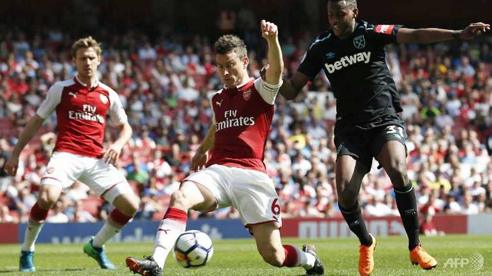 Football: Arsenal give Wenger reason to smile with West Ham hammering