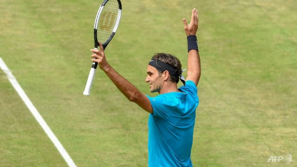 Tennis: Federer holds off Ebden to reach Halle semi-finals