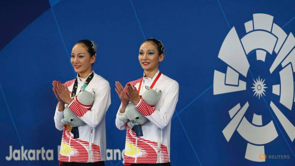 Twins make it a double sister act in Jakarta synchro final