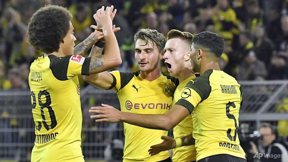 Football: Seven-up Dortmund keep heat on Bayern Munich