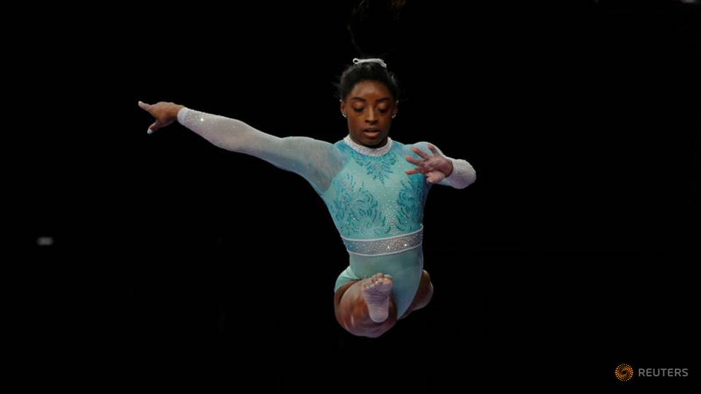 Gymnastics: Biles makes history with fourth all-around world title