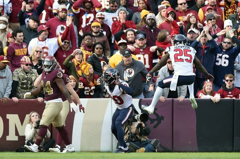 Texans triumph as Redskins' Smith hurt, Saints soar