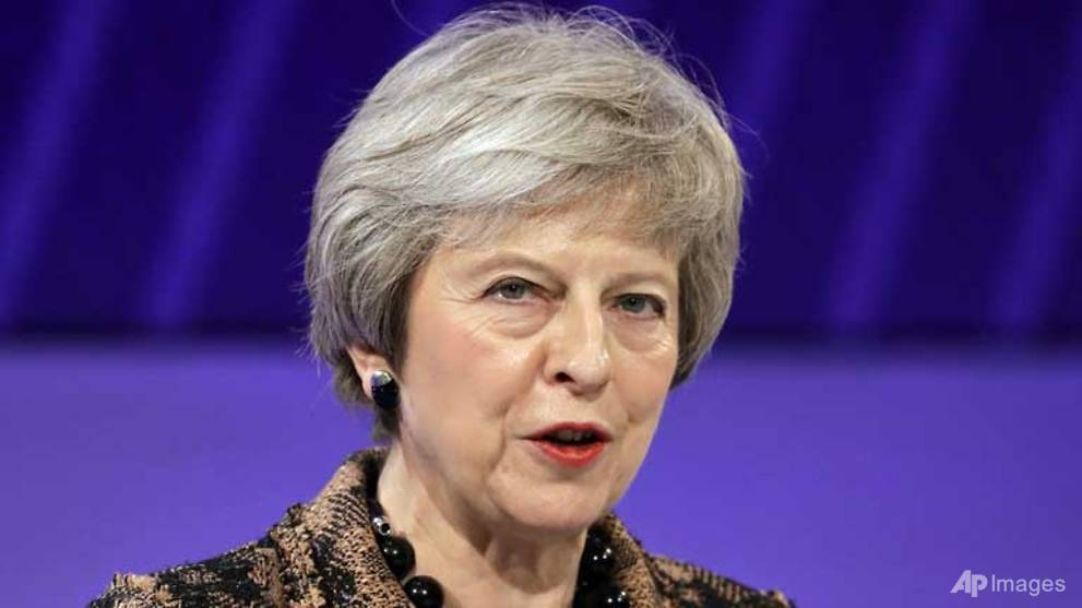 PM May wins business support for draft Brexit deal