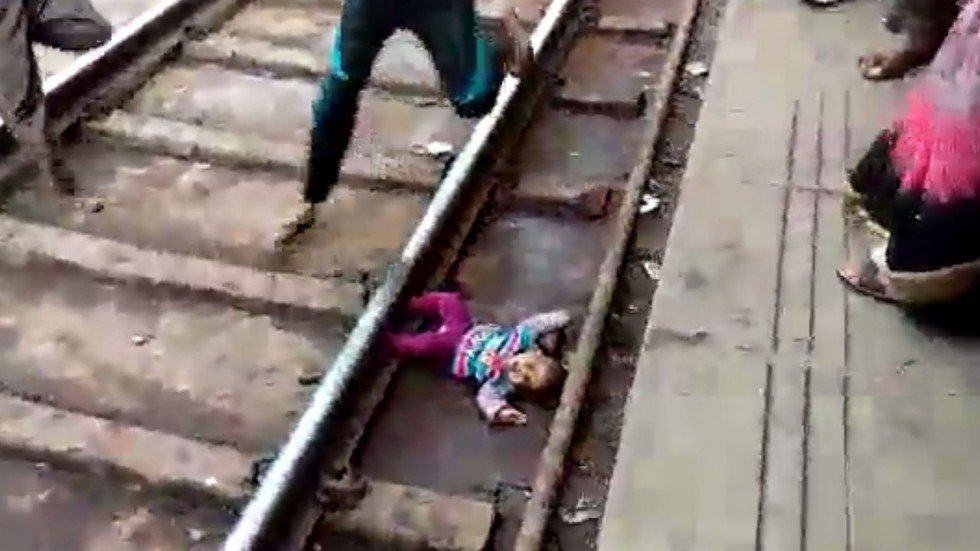 Baby girl dropped onto railway tracks in India survives being run over by a train