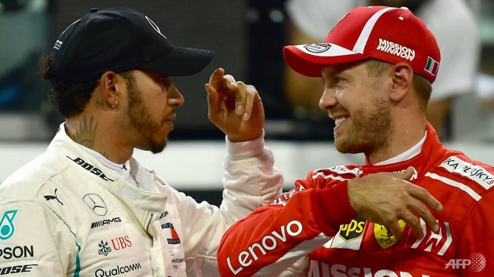 Motor racing: Foes Hamilton and Vettel swap helmets