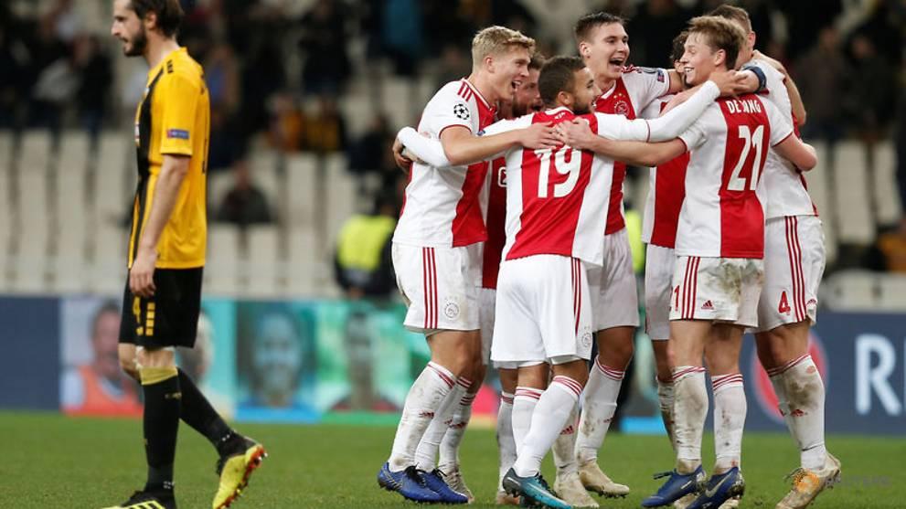 Tadic double sends Ajax into Champions League last 16