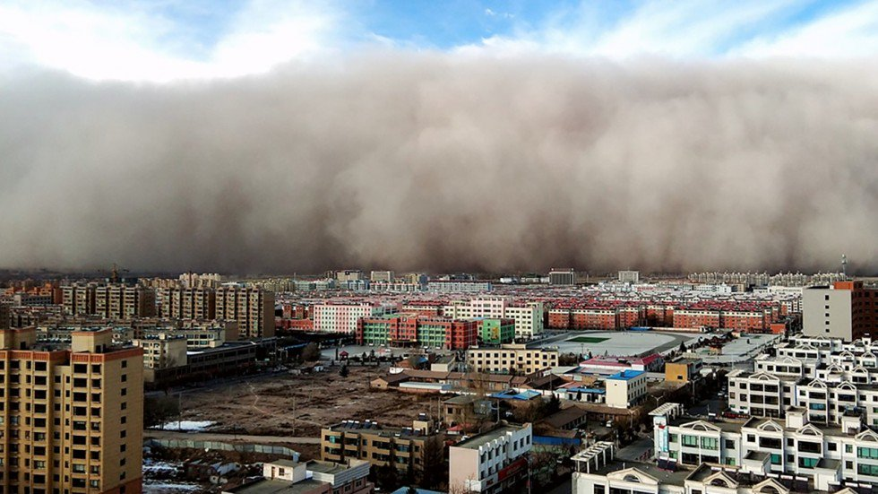 Chinese city 'swallowed' as ferocious sandstorm creates blizzard of hazards for police and firefighter