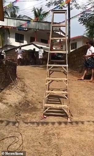 It's a step ladder! Equipment appears to walk by itself in India