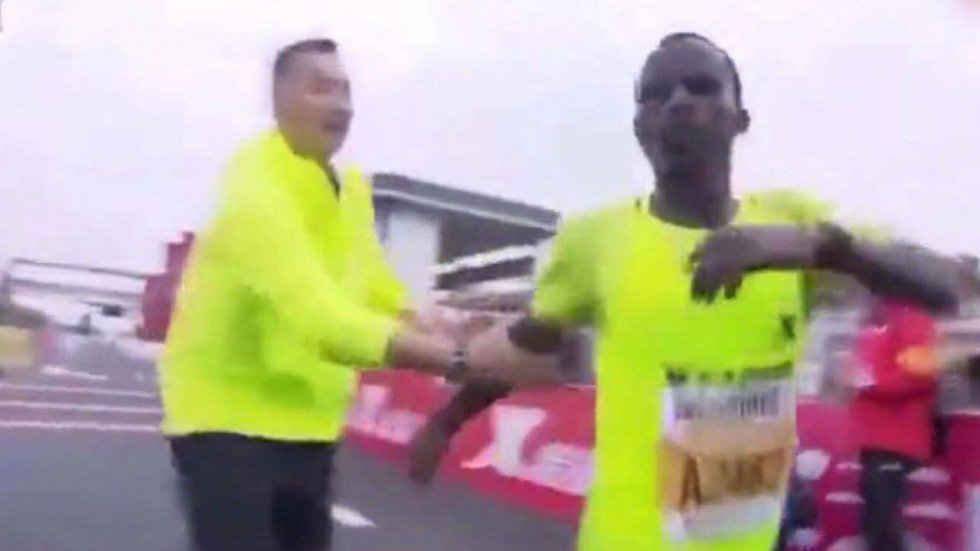 More marathon drama in China as Ethiopian runner forced to a stop at finish line