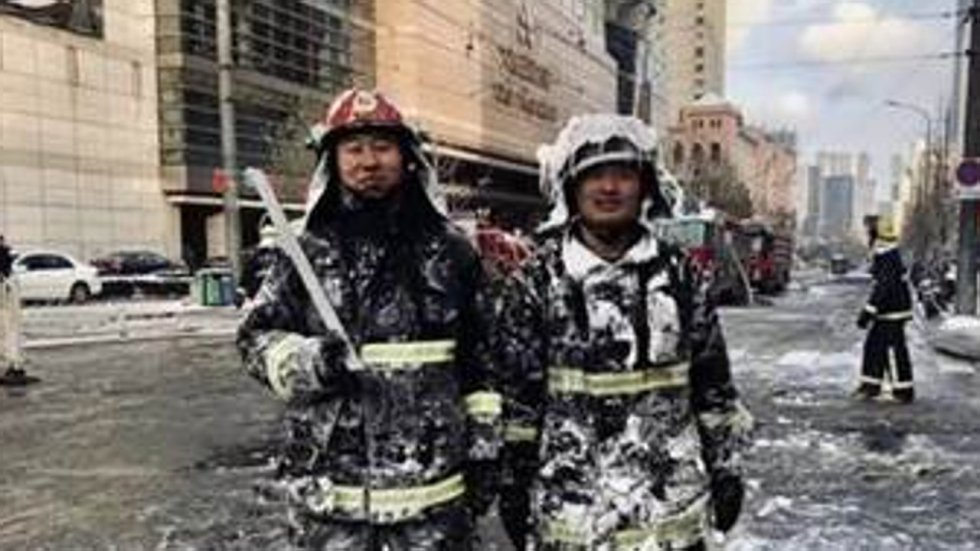 Chinese firefighters warm hearts as frozen kittens rescued from burnt-out building