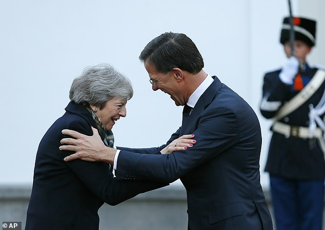 NEIN! NON! NEE! Theresa May gets a cool reception from three EU leaders on her begging tour to 'save Brexit' as Merkel, Juncker and Rutte dismiss pleas to renegotiate deal