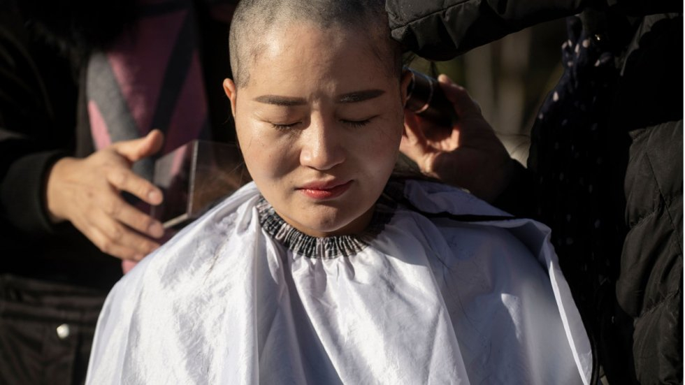 Wife, supporters of detained Chinese lawyer shave heads in protest