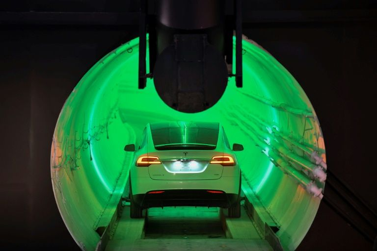 Elon musk bores tunnel to revolutionize city driving