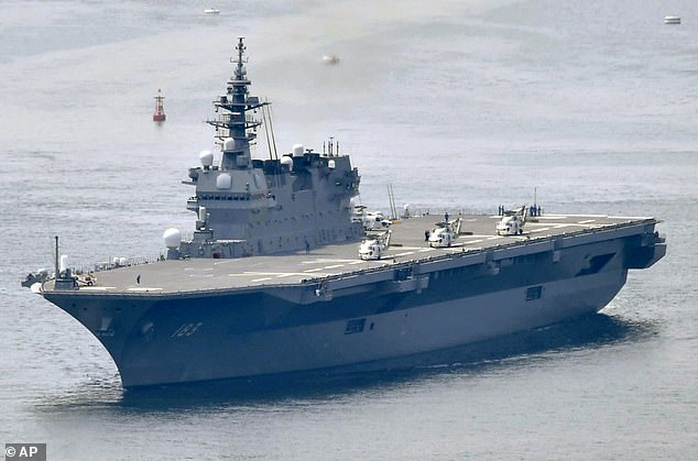 Japan will get its first aircraft carriers since WWII and buy dozens of fighter jets in response to China's growing military power
