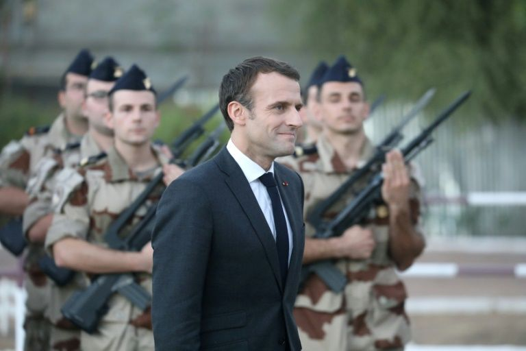 Macron takes champagne and foie gras to french soldiers in chad