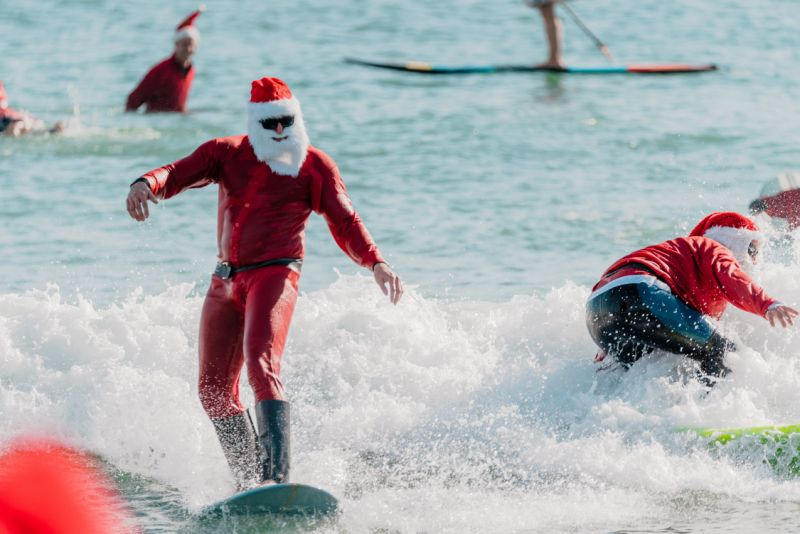 600 Surfing santas make a big splash in cocoa beach, Florida