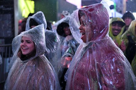 Times square awash in cold rain, high spirits in waning hours of 2018
