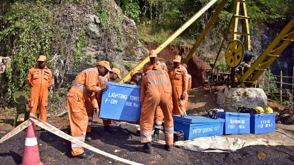 Indian rescuers struggle to pump out water from flooded mine