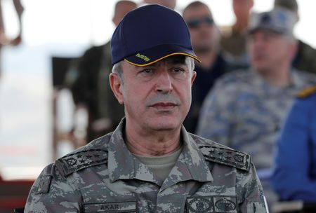 Near syrian border, turkish defence minister vows operation when time is right