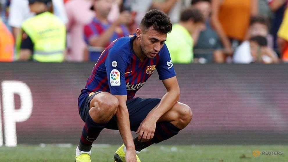 Sevilla sign Barca striker Munir at cut-price fee