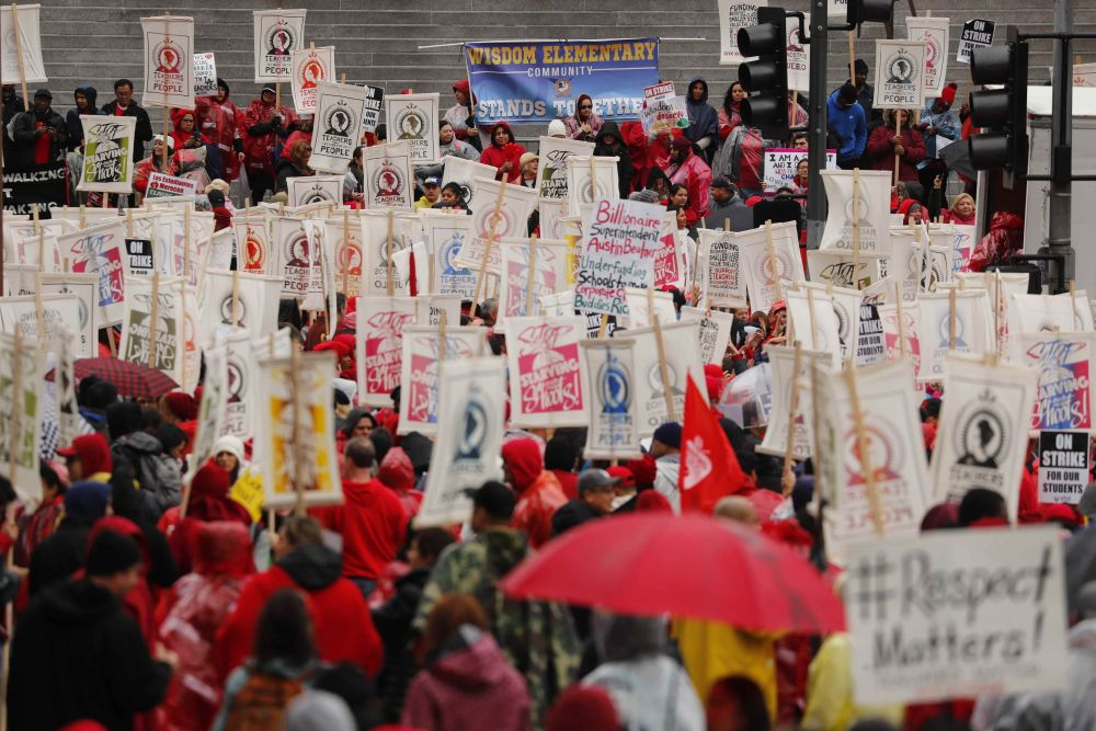 Striking Los Angeles teachers picket in rain with no deal imminent