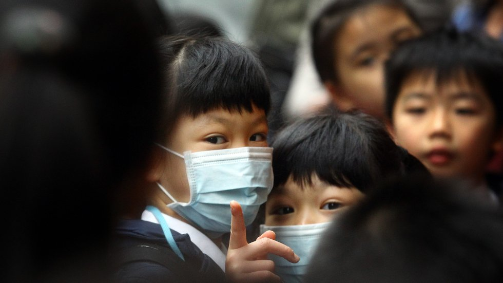 International kindergarten closes after flu outbreak, as government monitors two public school similarly affected