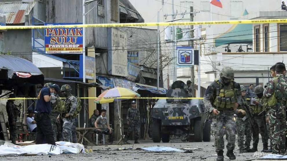 Twin bomb attacks on Philippine church kill at least 18