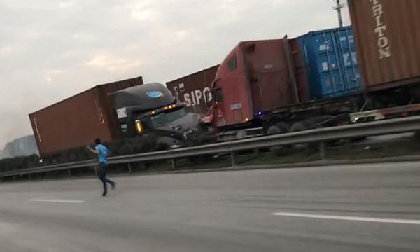 越南一男子高速公路遭遇撞车事故跳跃隔离带险逃生