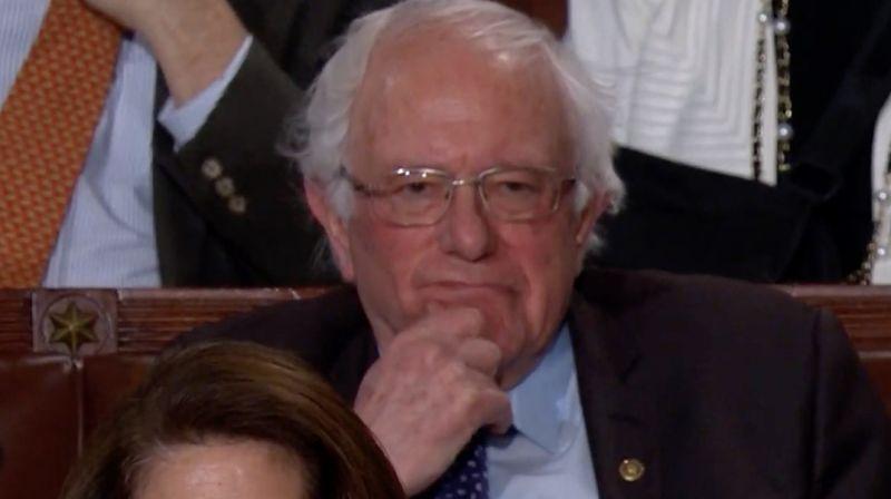 Trump knocks socialism and bernie sanders does not look pleased
