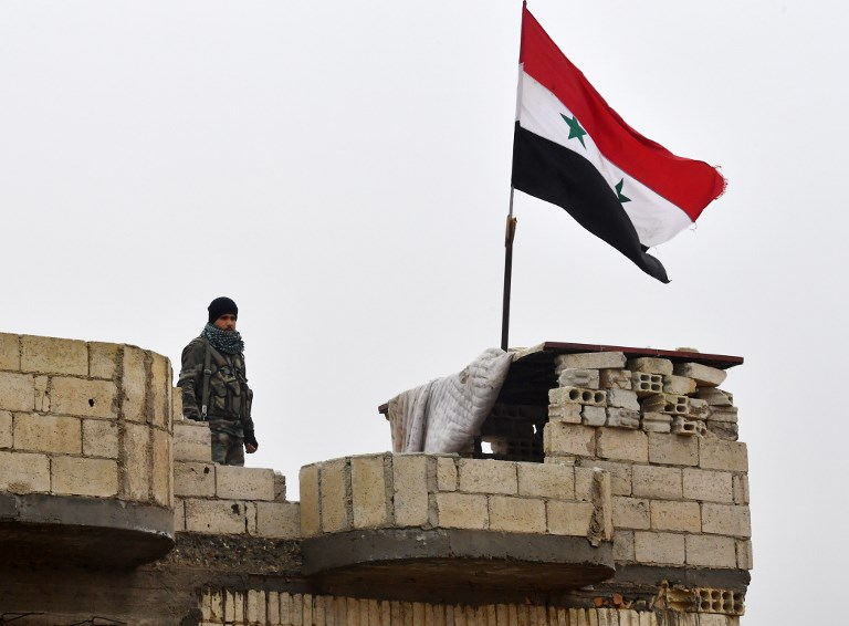 Kurdish fighters withdraw from key Syrian border cityMove follows appeal to Damascus for support against planned Turkish offensive