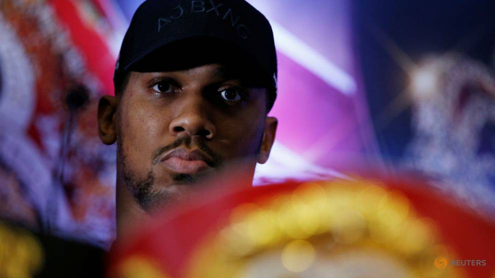 Boxing - Surgeon Joshua vows to reconstruct Miller's face in New York
