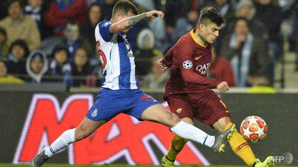Football: Telles penalty edges Porto past Roma in extra time
