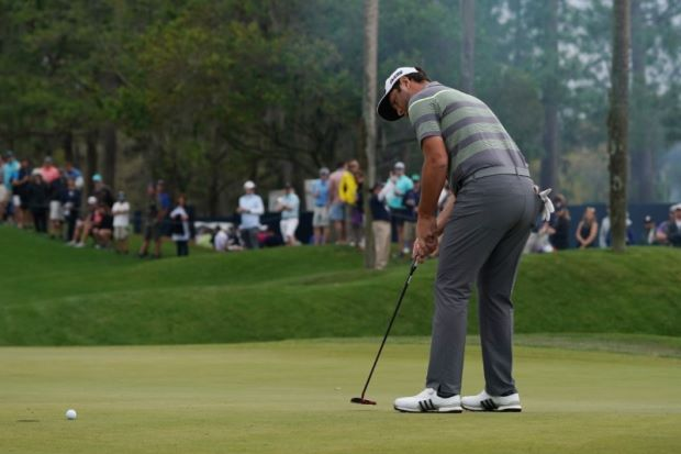 Golf - Rahm shoots 64 to lead McIlroy, Fleetwood at Players
