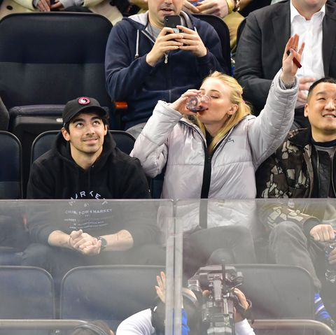 Sophie Turner Chugging Wine on a Jumbotron During a Hockey Game Is Iconic