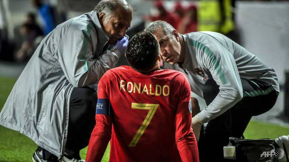 Football: Ronaldo injured as Portugal held by Serbia