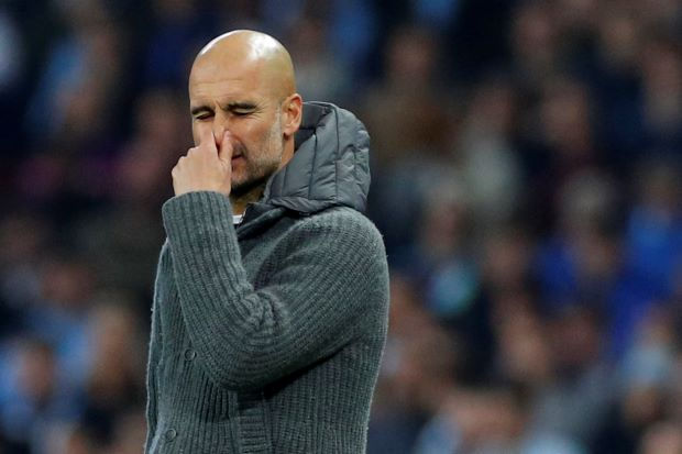 Guardiola vows City will 'stand up' in title race after 'cruel' exit