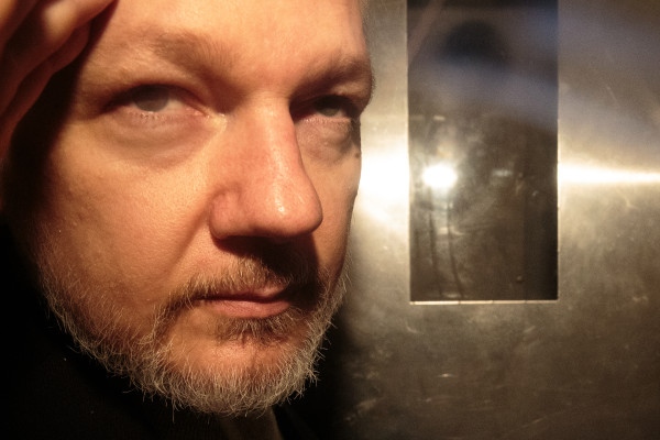 Julian Assange jailed for 50 weeks for breaching UK bail conditions