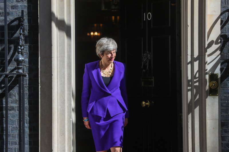 Theresa May should set resignation date next week, says lawmaker