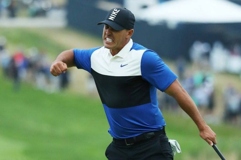 Koepka holds off late Johnson charge to win PGA Championship