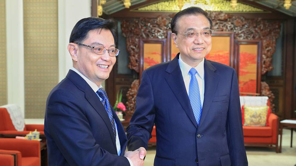 China will treat businesses equally, continue to uphold free trade: Li Keqiang