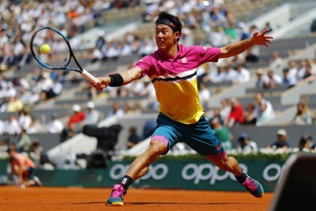 Nishikori downs Tsonga to reach French Open third round