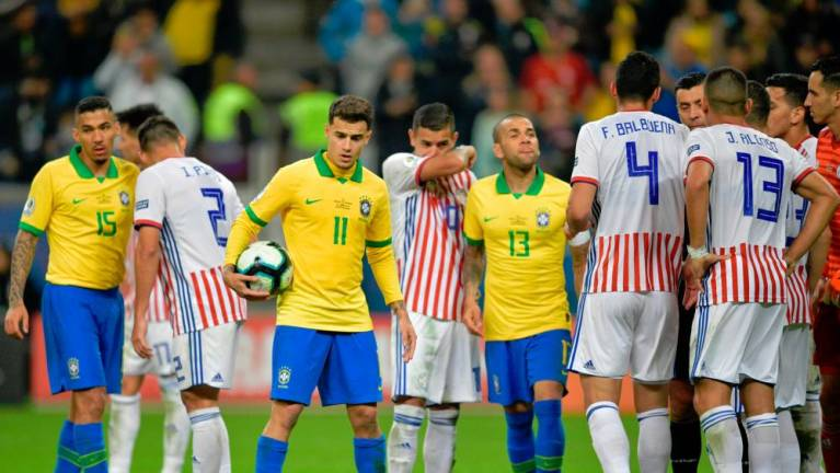 Brazil exorcise Paraguay penalty demons to reach Copa semis