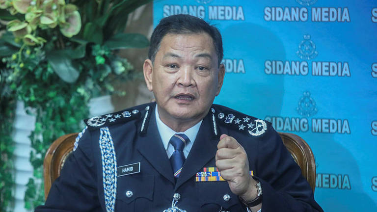 MyKad syndicate: More NRD officers to be detained