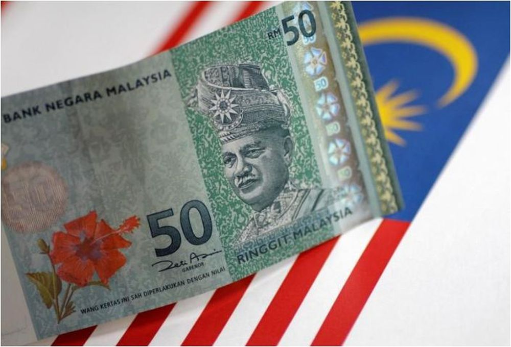 Ringgit slips further at the close
