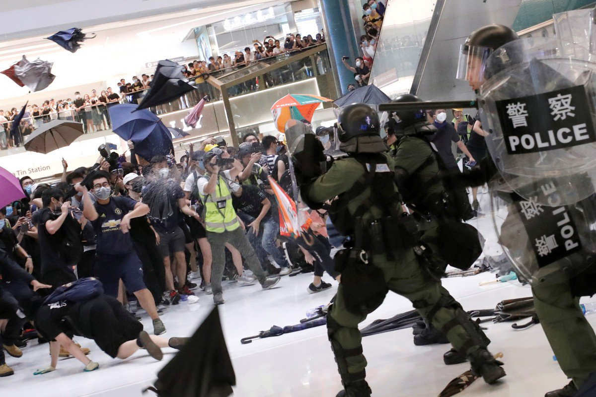 Head wounds, a severed finger, police and protesters in hospital: how a peaceful rally in Hong Kong descended into bloodshed and chaos in Sha Tin's New Town Plaza mall